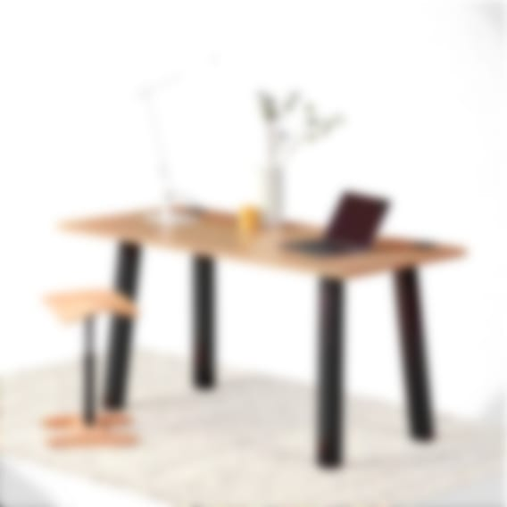 Boden seated fixed-height standing desk laminate oak top with black frame. Beam desk lamp in white with tic-toc chair in natural wood
