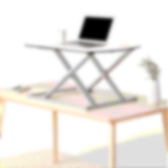 fully cora standing desk converter extended on desk white