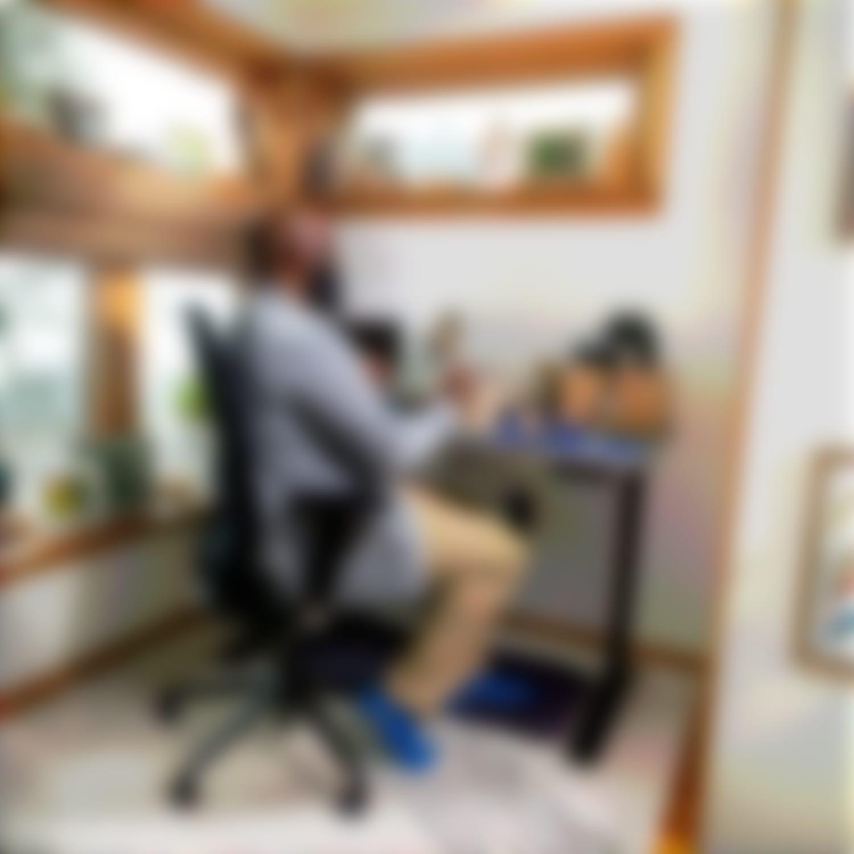 Man sitting at blue designer ply desk